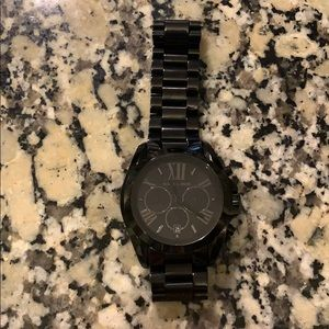 Oversized black Michael Kors watch.